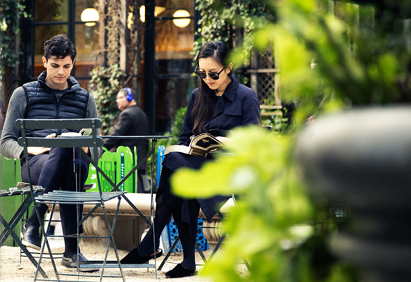 A Couple Enjoys Reading at Their Outdoor Cafe Table