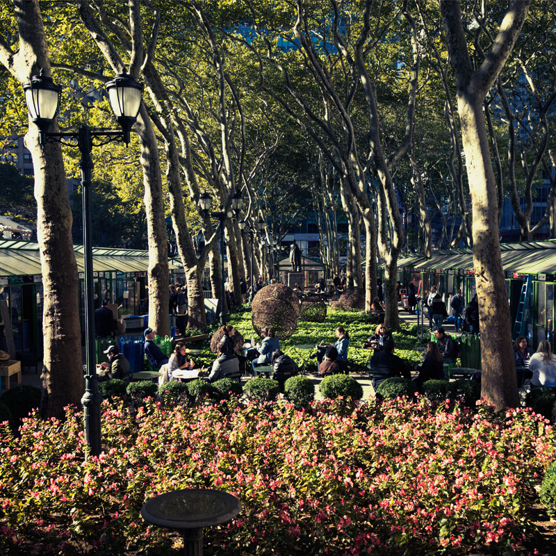 A Crowd of People Utilize a Beautiful Outdoor Courtyard in Bryant Park