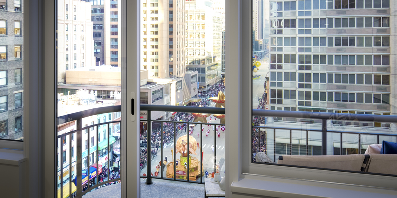 A Parade Passes By an Upper Level Hollingsworth Apartment