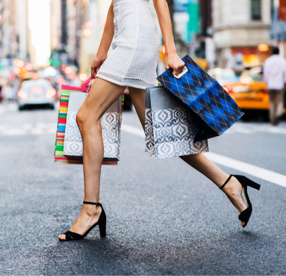 Lower Third Shot of a Woman Wearing Heels Holding Several Shopping Bags